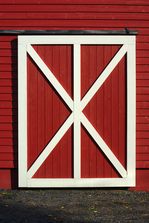 door of cowshed, red barn white plank closeup wood shed