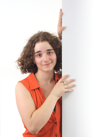 girl holding board with white background, orange shirt and cardboard