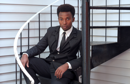 buisinessman: young professional man buisinessman sitting stairs handsome modern style executivevv Stock Photo