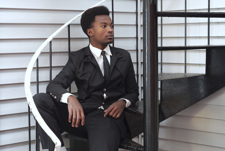 buisinessman: young professional man buisinessman sitting stairs handsome modern style executive