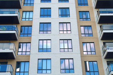 modern architecture wall facade windows residential building condominium skyscraper apartment Stock Photo