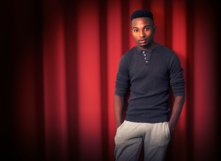 stand up comedy comedian stage red curtain show entertainment night Banque d'images