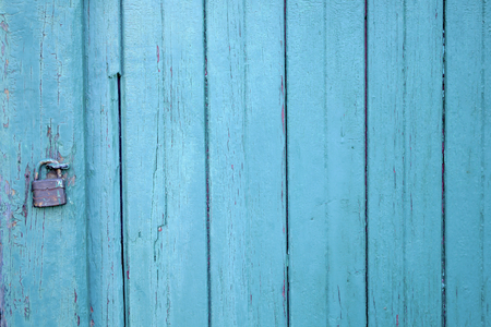 padlock painted wood door old vintage scaled blue paint background