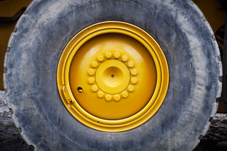 tire truck yellow wheel construction vehicle heavy machine Reklamní fotografie