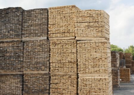 wood planks stacked wooden lumber yard construction