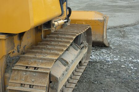 Bulldozer caterpillar closeup yellow perspective view