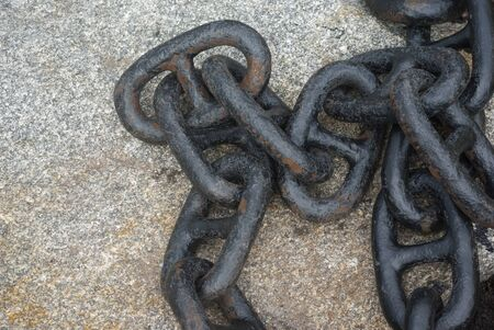 black rusted metal boat chain on concrete