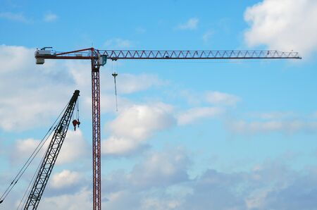 cranes on construction site for lifting heavy equipment