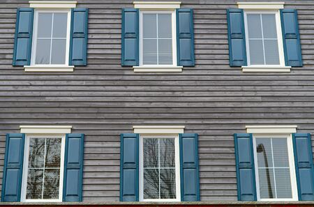 house windows residential facade old style blue gray wood