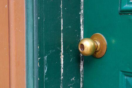 old door handle brass doorknob green painted wood