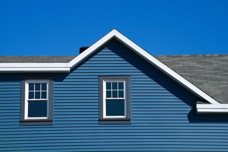 blue home house facade and window rooftop and sky
