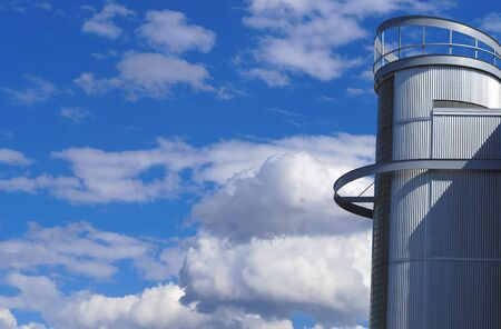 futuristic building tower business cylindrical metal structure on blue sky