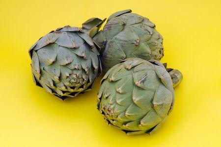 three artichoke organic green vegetable healthy nutrition Stock Photo