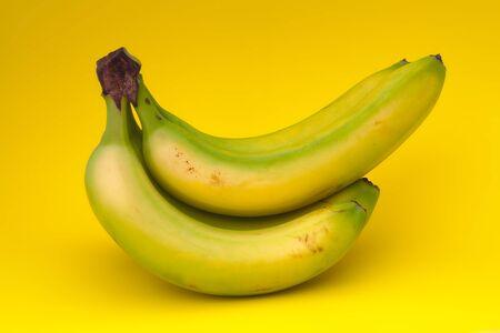 bunch of banana on yellow background
