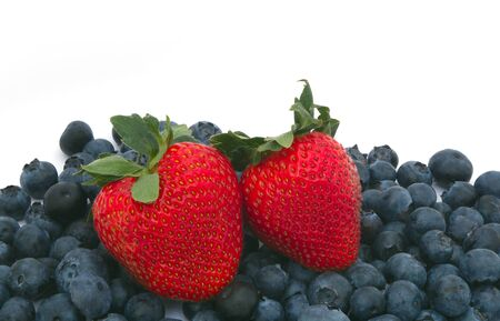 strawberries and blueberries on white background close-up