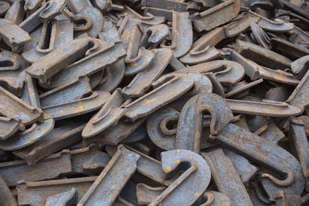 many metal pieces heap detached rusty iron parts