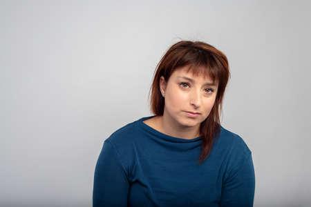 woman wondering people thirty year old studio portrait in blue sweater