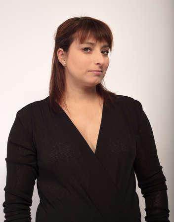 business portrait woman in black dress vertical businesswoman in studio
