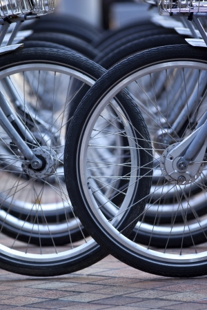 Bicycle wheels on a parking in the city