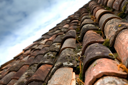 Old tiled roof with foam