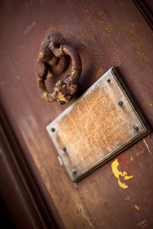 french doors: Rusty knocker of an old door