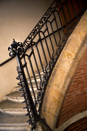 metal handrail: Old stairs inside a house Stock Photo
