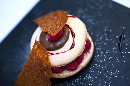 Macaroon with raspberries and biscuit photo