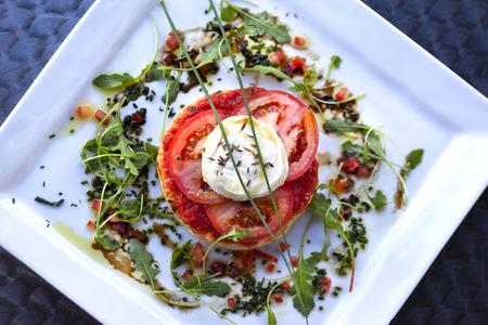 Tomato tart, goat cheese and green salad Standard-Bild