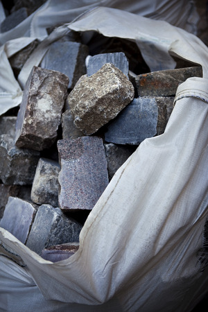 weighty: Bag on cobblestones on a construction site