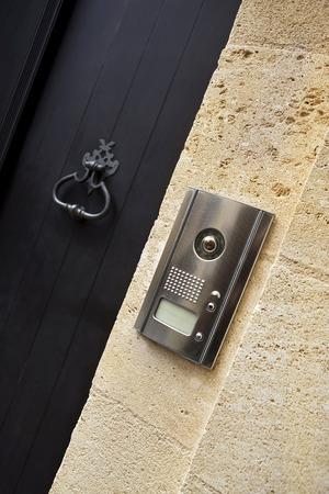 intercom: Intercom and door knocker Stock Photo