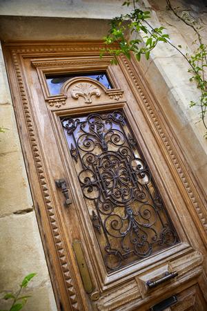 iron gate: Stylish wooden door Stock Photo