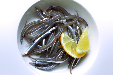 gastronomic: Small fishes on a plate Stock Photo