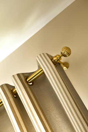 Curtain and brass rod in a house