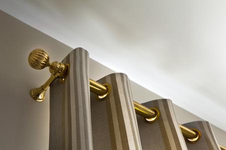 Brass curtain rod in a house Standard-Bild