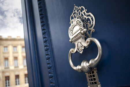 Stylish door knocker on the door of a French mansion in Bordeaux