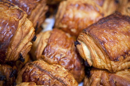 crust crusty: Focus on French pastries in a bakery Stock Photo