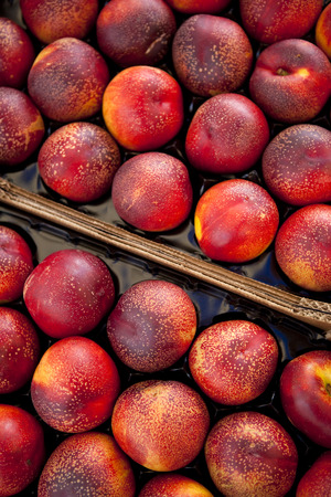 carboard box: Nectarines on a market stall