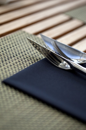 Fork and knife on a table set up photo
