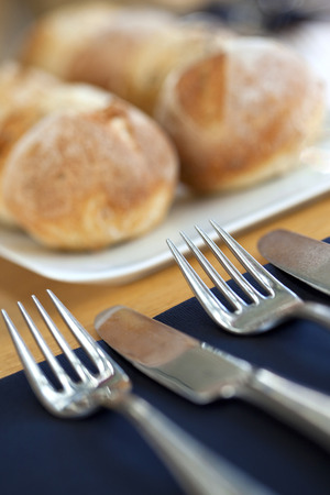 Bread, fork and knife on a table photo