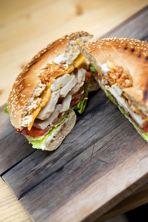 gastronomic: Gastronomic bagel on a wooden table