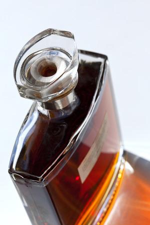 cognac: Bottle of Cognac on a table Stock Photo