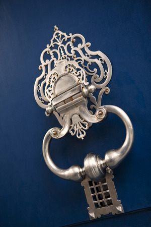 french doors: Stylish French door knocker of a mansion Stock Photo