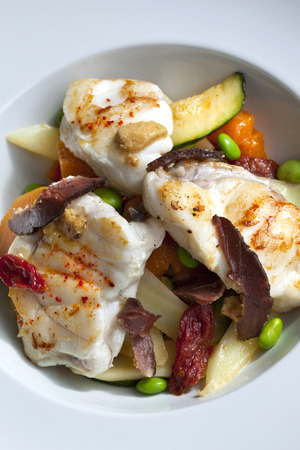 burbot: Burbot, duck ham and vegetable on a plate Stock Photo