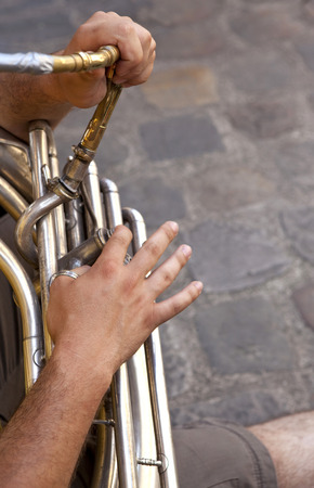 tuba: Musician playing tuba in a marching band