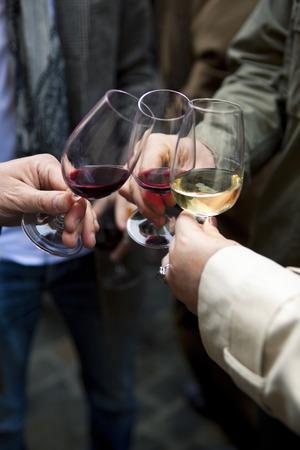 Friends tasting Bordeaux wine in a winery