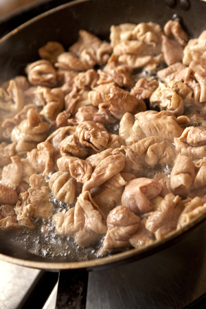 chitterlings: Frying Chitterlings in a pan Stock Photo