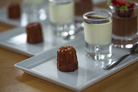 crust crusty: French cake Canele and vanilla cream Stock Photo