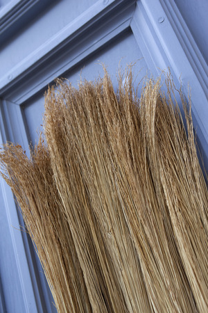 brooms: Straw brooms on a market stall Stock Photo