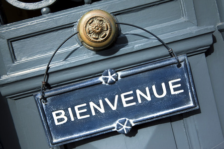 Welcome sign on the door of a French inn