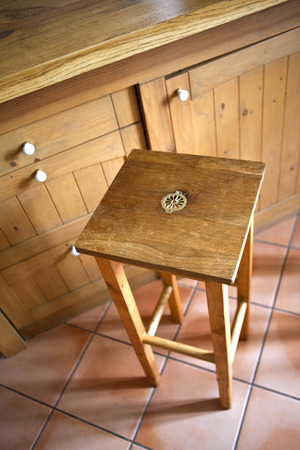 stool: Wooden stool in a kitchen